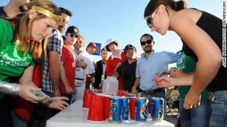 """Notre Dame fans play """"flip cup"""" before watching their team play."""